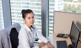 Young asian business woman with notebook in the office. In high floor in front of the window Stock Photos