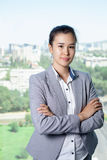 Young asian business woman with notebook in the office. In high floor in front of the window Royalty Free Stock Images