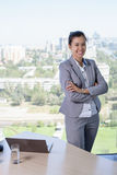 Young asian business woman with notebook in the office. In high floor in front of the window Royalty Free Stock Photo