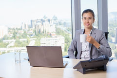 Young asian business woman with notebook in the office Royalty Free Stock Image