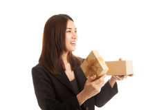 Young Asian business woman open a gift box. Young Asian business woman open a gift box  isolated on white background Stock Photos