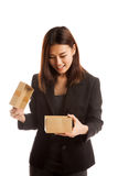 Young Asian business woman open a gift box. Young Asian business woman open a gift box  isolated on white background Royalty Free Stock Photos