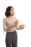 Young Asian business woman open a gift box Royalty Free Stock Photo