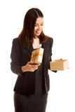 Young Asian business woman open a gift box. Young Asian business woman open a gift box  isolated on white background Stock Images