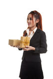 Young Asian business woman open a gift box. Young Asian business woman open a gift box  isolated on white background Stock Photography