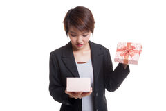 Young Asian business woman open a gift box. Royalty Free Stock Image