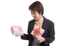 Young Asian business woman open a gift box. Royalty Free Stock Images