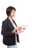 Young Asian business woman open a gift box. Royalty Free Stock Photography