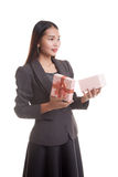 Young Asian business woman open a gift box. Young Asian business woman open a gift box  isolated on white background Royalty Free Stock Image
