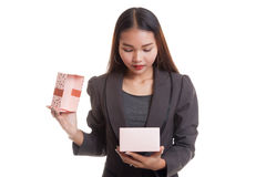 Young Asian business woman open a gift box. Young Asian business woman open a gift box  isolated on white background Stock Image