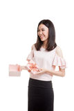 Young Asian business woman open a gift box. Young Asian business woman open a gift box  isolated on white background Stock Photo