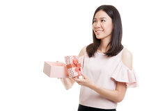 Young Asian business woman open a gift box. Young Asian business woman open a gift box  isolated on white background Royalty Free Stock Photography