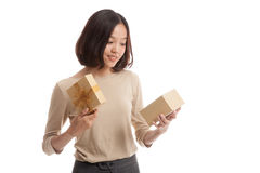 Young Asian business woman open a gift box. On white background Stock Photos