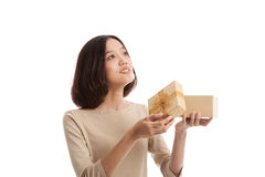 Young Asian business woman open a gift box. On white background Royalty Free Stock Photo