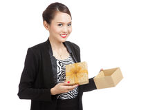 Young Asian business woman open a golden gift box Royalty Free Stock Photography