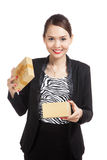 Young Asian business woman open a golden gift box. Isolated on white background Royalty Free Stock Photos