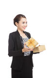 Young Asian business woman open a golden gift box. Isolated on white background Royalty Free Stock Image