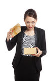 Young Asian business woman open a golden gift box Stock Image