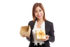 Young Asian business woman open a golden gift box. Isolated on white background Royalty Free Stock Photography