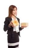 Young Asian business woman open a golden gift box. Isolated on white background Royalty Free Stock Photo