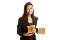 Young Asian business woman open a golden gift box. Young Asian business woman open a golden gift box  isolated on white background Stock Images