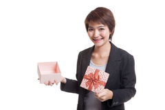 Young Asian business woman open a golden gift box. Royalty Free Stock Images