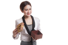 Young Asian business woman open a golden gift box. Young Asian business woman open a golden gift box  isolated on white background Stock Photo