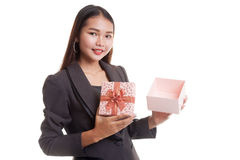 Young Asian business woman open a golden gift box. Young Asian business woman open a golden gift box  isolated on white background Royalty Free Stock Image