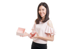 Young Asian business woman open a golden gift box. Young Asian business woman open a golden gift box  isolated on white background Royalty Free Stock Images