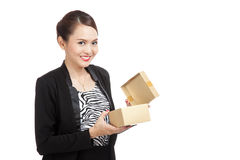 Young Asian business woman open a golden gift box. On white background Stock Image