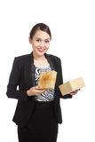 Young Asian business woman open a golden gift box. On white background Royalty Free Stock Photo