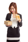 Young Asian business woman open a golden gift box. On white background Royalty Free Stock Photos