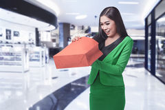 Young asian business woman opening her shopping bag Stock Photo