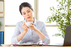 Young asian business woman overworked with uncomfortable Royalty Free Stock Image