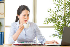 Young asian business woman overworked with uncomfortable Royalty Free Stock Photography