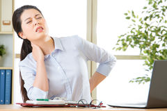 Young asian business woman with pain in neck Stock Photos