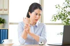 Young asian business woman with pain in wrist Royalty Free Stock Photos