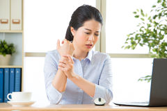 Young asian business woman with pain in wrist Royalty Free Stock Image