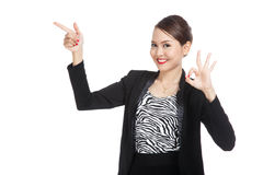 Young Asian business woman  point and show OK Stock Photos
