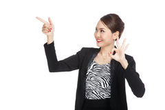 Young Asian business woman  point and show OK Royalty Free Stock Photo