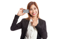Young Asian business woman point to a blank card Stock Images