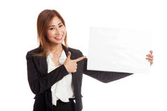 Young Asian business woman point to  blank sign Stock Photography