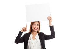 Young Asian business woman point to  blank sign Royalty Free Stock Images