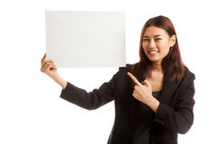 Young Asian business woman point to  blank sign. Royalty Free Stock Photo
