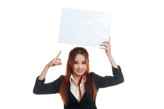 Young Asian business woman point to  blank sign. Stock Photo