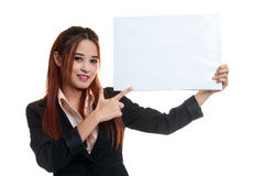 Young Asian business woman point to  blank sign. Royalty Free Stock Images