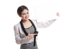 Young Asian business woman point to  blank sign. Royalty Free Stock Photography