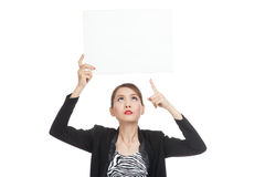 Young Asian business woman point to  blank sign Royalty Free Stock Photography