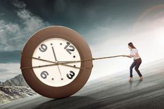 Free Young Asian Business Woman Pulling Clock With Rope Royalty Free Stock Photography - 111380977