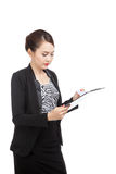 Young Asian business woman read paper on clipboard Stock Photography